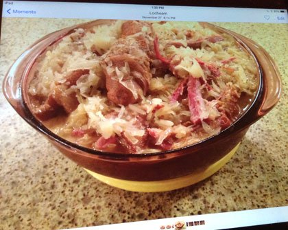 Why is sauerkraut a traditional holiday side dish in Baltimore? Where did it originate?