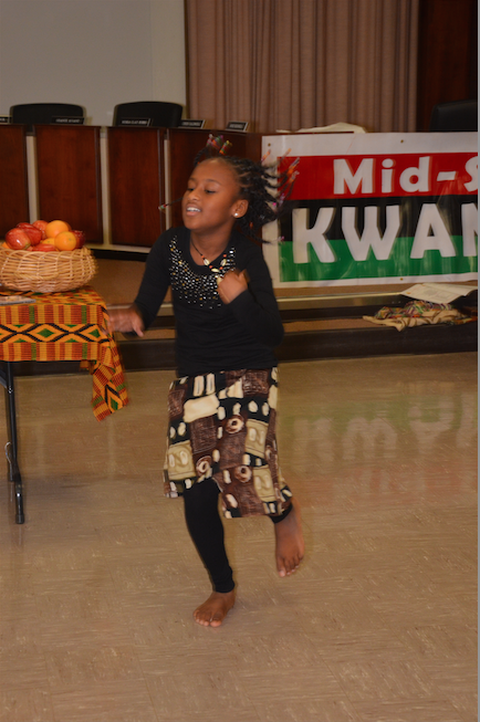 The focus was on children at the Shelby County Board of Education auditorium for the UMOJA – unity – celebration during the first day of Kwanzaa 2014. The sponsors were SCS Shape, the Orange Mound Progressive Club and Mid-South Kwanzaa, Inc. (Photo: Tyrone P. Easley)