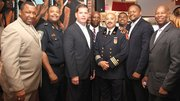 Black public safety officials gathered at Darryl's Corner Bar and Kitchen (l-r): Suffolk County Sheriff Steve Tompkins, Police Superintendent-In-Chief William Gross, Mayor Martin Walsh, Urban League of Eastern Massachusetts President and CEO Darnell Williams, Deputy Fire Chief Andre Stallworth, Darryl's Corner Bar Manager Mitch Mitchell, NAACP Boston Branch President Michael Curry and restaurateur Darryl Settles.