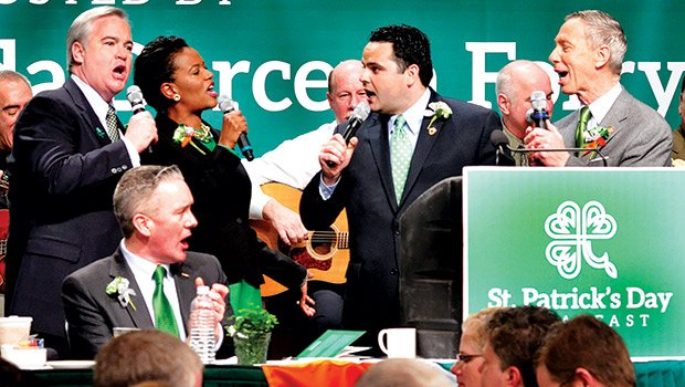 State Sen. Linda Dorcena Forry joins South Boston politicians in song at the annual St. Patrick's Day Breakfast. (l-r) at-large City Councilor Michael Flaherty, state Sen. Michael Rush (seated), Forry, state Rep. Nick Collins and U.S. Rep. Stephen Lynch.