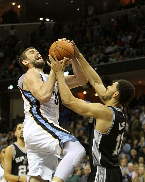 Grizz center Marc Gasol drives to the basket and is fouled by Jeff Ayres of the Spurs. (Photo: Warren Roseborough)
