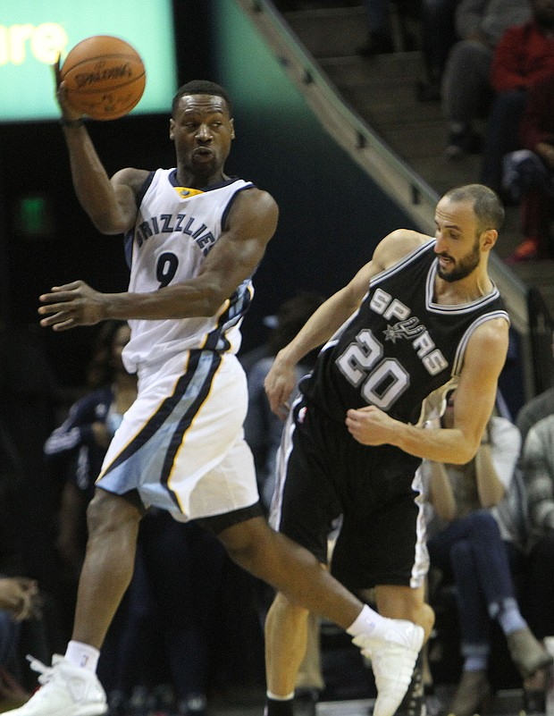 Tony Allen makes a leaping save as Manu Ginobili of the Spurs tries to avoid the contact. (Photo: Warren Roseborough)