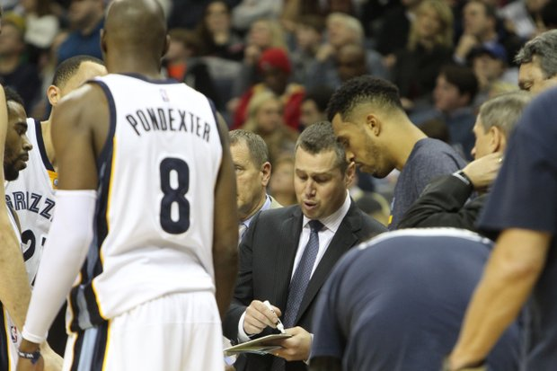 Memphis' head coach Dave Joerger draws up a play during a timeout as Courtney Lee takes in the instruction. (Photo: Warren Roseborough)