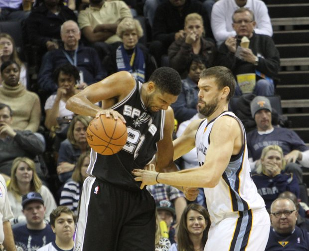 Marc Gasol of the Grizzlies is called for the foul on Tim Duncan of the Spurs. Marc Gasol (Right) of the Grizzlies is called for the foul on Tim Duncan of the Spurs.