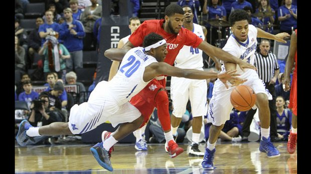 Going all out Avery Woodson (left) of the Memphis Tigers dives and comes up with the loose ball. (Photo: Warren Roseborough)