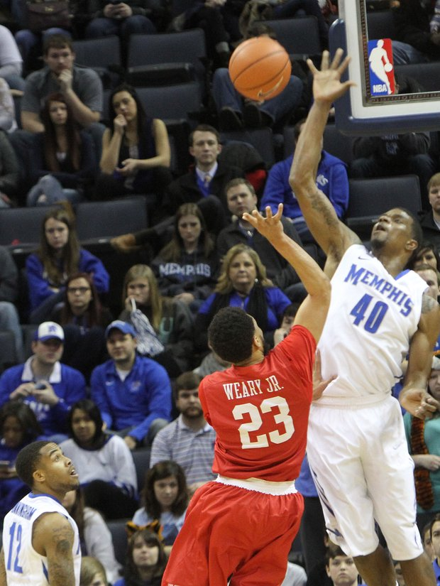 Calvin Godfrey of the Tigers blocks the shot of Eric Weary Jr. of Houston. (Photo: Warren Roseborough)