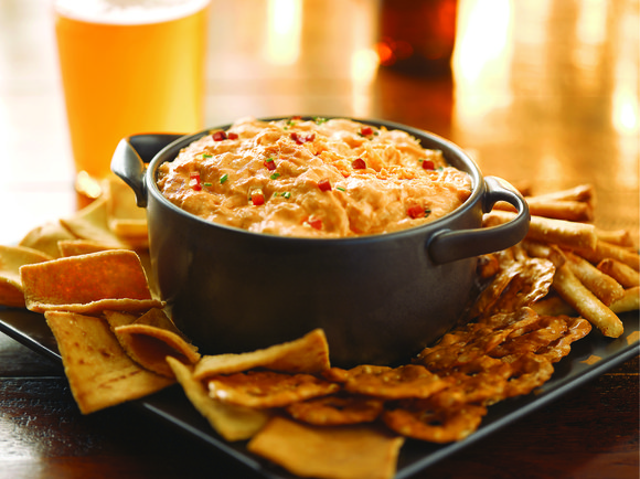 Buffalo Chicken Dip is a robust, creamy dip featuring the unforgettable buffalo flavor and chicken, but without the mess. It's ...