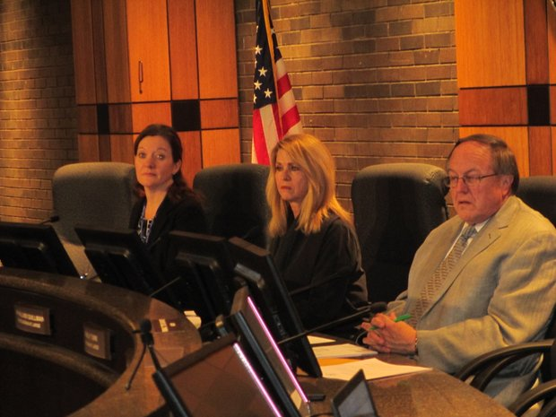 The Joliet Electoral Board, made up of Joliet City Clerk Christa Desiderio and council members Jan Quillman and Mike Turk, listen to statements made by Councilwoman Bettye Gavin and her political opponent James Foster.
