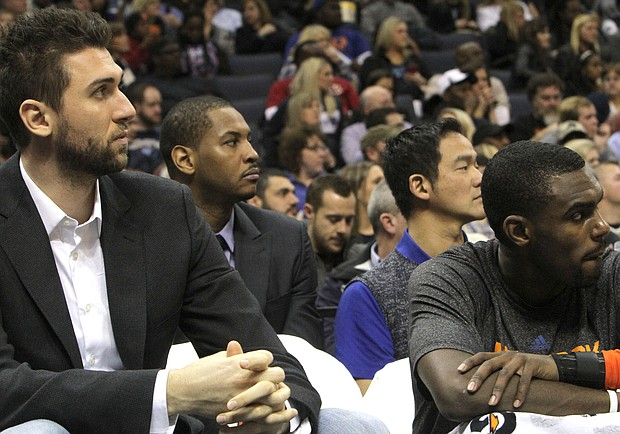 New York's Carmelo Anthony (second from left), who is injured, assumed the role of spectator on the Knicks bench. (Photo: Warren Roseborough)