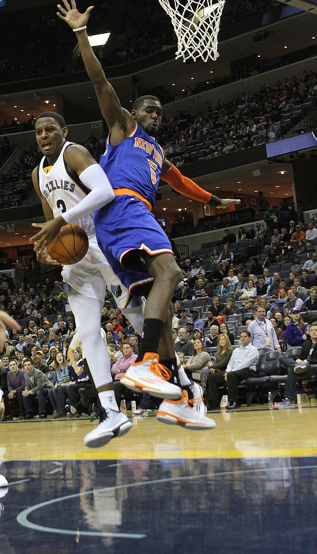 Jordan Adams grabs a rebound over Tim Hardaway Jr. of the Knicks. (Photo: Warren Roseborough)