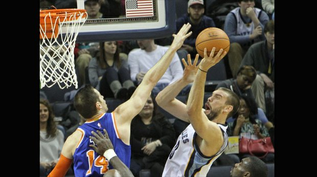 Marc Gasol of the Grizzlies scores over Jason Smith of the Knicks. (Photo: Warren Roseborough)