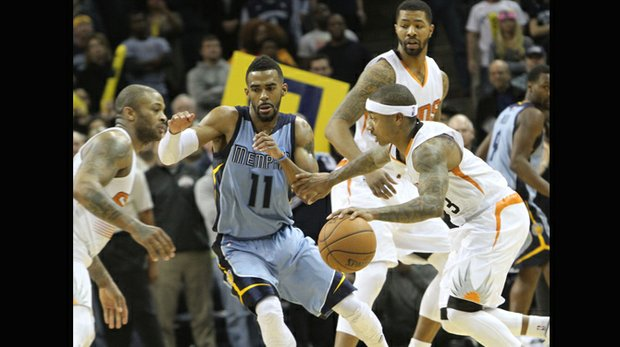 Mike Conley of the Grizzlies tries to fight through a screen to defend Isaiah Thomas of the Suns. (Photo: Warren Roseborough)