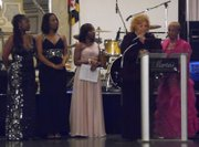 Gala Chairs Angela Humphrey, Lynetta Parker, and Tasha Franklin Johnson; Dr. Joann Christopher Hicks, president; and Dolores L. Winston, Award Recipient.