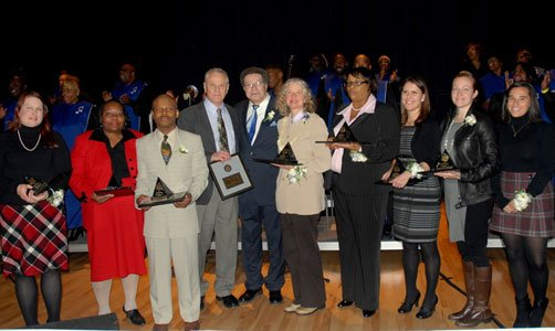 (Left to right) Community Service Award Winners Margaret Strong; Rochelle Mariano; Nelson Moody Sr.; keynote speaker Morris Dees, founder of the Poverty Law Center; Dr. Levi Watkins Jr. retired Johns Hopkins University professor and founder of the Annual Martin Luther King Jr. Commemoration; and Community Service Award Winners Janine Coy; Harlisha Martin; Theresa Barberi; Danielle Chi (wife of Dr. Albert Chi, who accepted the award on his behalf because of his deployment); and Adi Noiman at the 33rd Annual Martin Luther King, Jr. Commemoration at Johns Hopkins Medicine's Turner Auditorium on Friday, January 9, 2015.