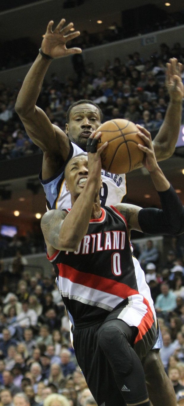 Damian Lillard requires tough defense and Tony Allen is on his back with just that in mind. (Photo: Warren Roseborough)