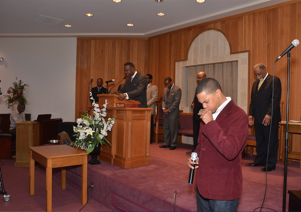 A moment of prayer at the annual observance of Dr. Martin Luther King Day at Monumental Baptist Church. The observance is coordinated by the Memphis Rainbow PUSH Coalition. (Photo: Tyrone P. Easley)