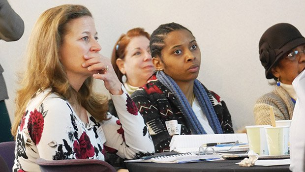 Local business owners listen Jan. 15 during an information session for a capacity-building program offered by Northeastern University and Next Street. NU's new master plan includes economic development in neighboring communities.