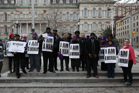 At a candlelight vigil on Friday, January 16, 2015, Baltimore security officers, local clergy and elected officials called on city ...