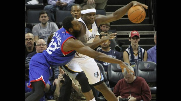 Zach Randolph of the Grizzlies appears unconcerned about the defensive effort of Luc Mbah a Moute of the 76'ers. Z-bo 17 points and 14 rebounds in Memphis' 101-83 romp over Philadelphia at the FedExForum on Saturday night. (Photo: Warren Roseborough)