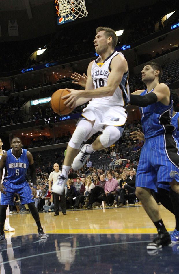 Beno Udrich of the Grizzlies grabs a big rebound late in the fourth quarter as Memphis glided by the Magic at the FedExForum. (Photo: Warren Roseborough)