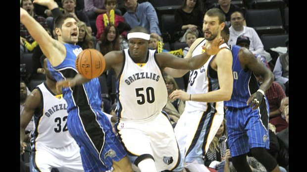 Zach Randolph, who was a handful for the Magic to defend, stakes his claim on this loose ball. (Photo: Warren Roseborough)