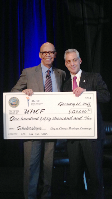 Dr. Michael L. Lomax, Ph.D, President and CEO, United Negro College Fund (UNCF) and Chicago Mayor Rahm Emanuel hold a check from the City of Chicago Employee Campaign for $150,000 that was donated to UNCF during  the organization's Inaugural Mayor's Luncheon.