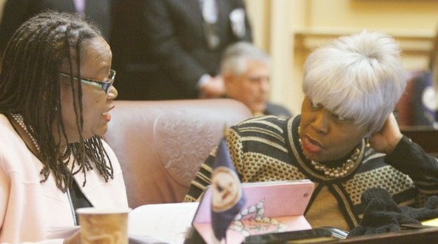 Virginia State Senators Mamie Locke of the 2nd District (Hampton) and L. Louise Lucas of the 18th District (Portsmouth) chat in the Senate chamber before the opening of the 2015 session of the General Assembly on Jan. 14, 2015.