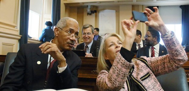 Newly elected members of the House of Delegates Joseph E. Preston of the 63rd District (Petersburg) and Kathleen Murphy of the 34th District (McLean) take a selfie on the opening day of the General Assembly, Jan. 14, 2015.