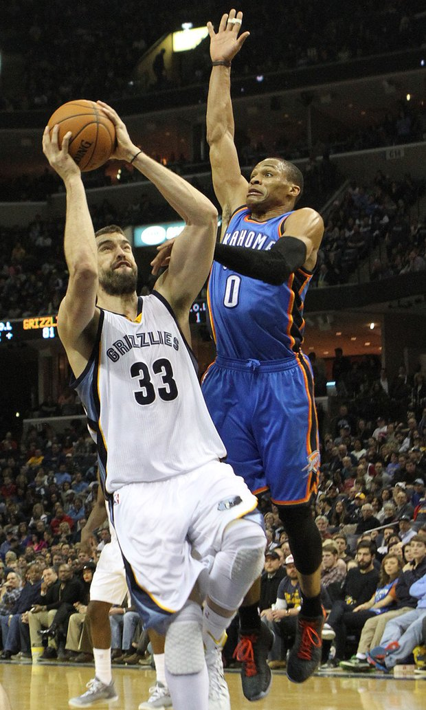 Marc Gasol of the Grizzlies drives pass Russell Westbrook of OKC and scores. (Photo: Warren Roseborough)