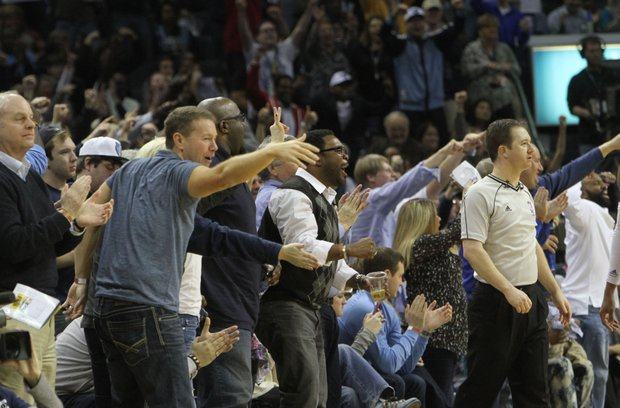 With a victory over the Atlanta Hawks in hand, fired-up Grizz fans celebrate as time winds down. (Photo: Warren Roseborough)