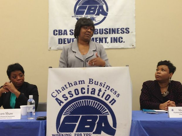 Gwen Shaw, Assistant Secretary, Chatham Business Association (CBA) (left) and Melinda Kelly  Executive Director, Chatham Business Association (CBA) (right) listen to Ald. Michelle Harris (8th Ward) as she shares some of her economic plans for her ward with CBA members and guests at its monthly meeting Feb. 10, 2015 held at the QBG Building at 806 E. 78th St. in Chicago.