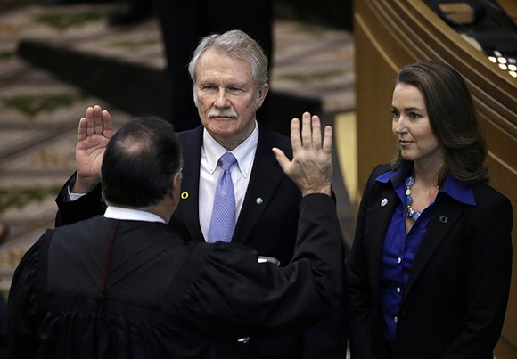Long-time Democratic Oregon Gov. John Kitzhaber on Friday announced his resignation amid allegations his fiancee used her relationship with him ...