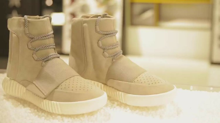 24da13c8e The controversial rapper personally handed out pairs of his new Yeezy Boost