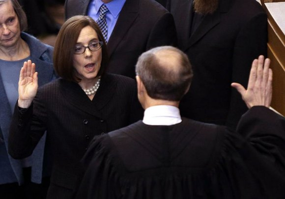 Kate Brown was sworn in Wednesday as Oregon's governor following an influence-peddling scandal that prompted the resignation of fellow Democrat ...