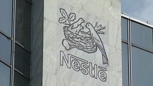 Nestle says it will become the first major candy maker to eliminate all artificial color and flavors from its chocolates.