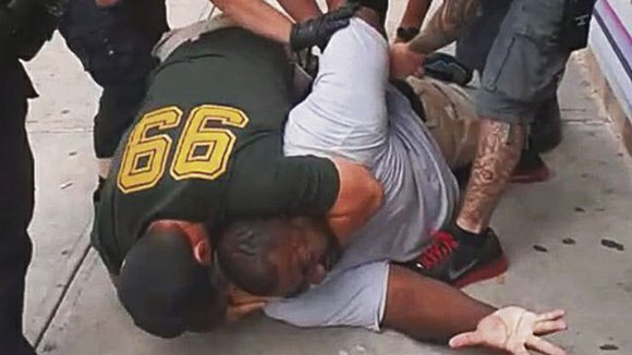 The police officer that put Eric Garner in a department-banned chokehold appeared for a hearing with the NYPD Thursday.