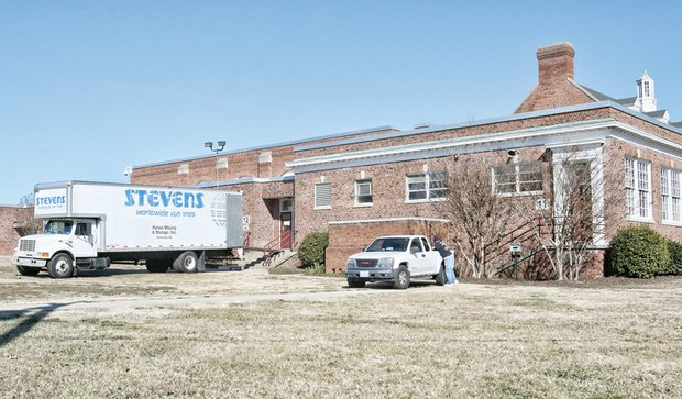 Movers are in place at Elkhardt Middle School to load and haul all school materials across town to Clark Springs Elementary School last Friday.