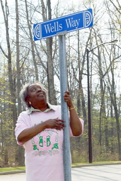The DeKalb County Library System honored Wells by naming the street after her in 2006.