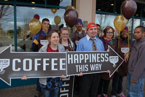 Clients celebrate the opening of Happy Cup Coffee Company on Northeast Killingsworth and Martin Luther King Jr. Boulevard.