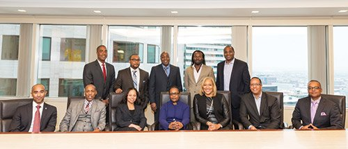 (l-r) (sitting) Christopher McDavid, Robert Johnson, Doreen Rachal, Stephanie S. Lovell, Sherry Williams, Damian Wilmot, Winston S. Kirton, (standing) Scott Mays, Jermaine Kidd, Bruce Jackson, John Shasanmi, Dominic Blue