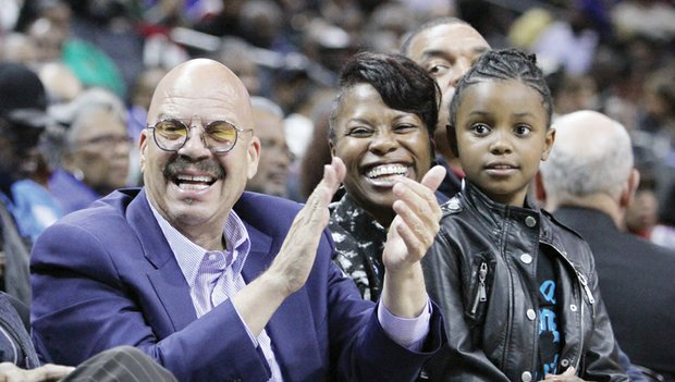 """National radio host Tom Joyner takes in a game with CIAA Commissioner Jacquie McWilliams and her daughter, Semone Carpenter, after broadcasting his """"Tom Joyner Morning Show"""" from the CIAA Fan Fest at the nearby Charlotte Convention Center"""
