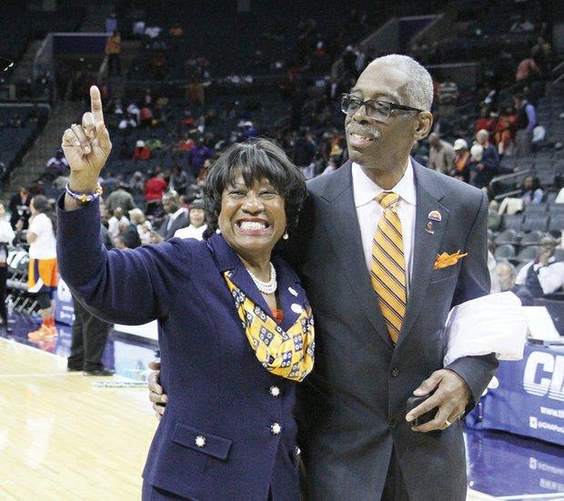 Virginia State University's interim President Pamela V. Hammond and her husband, Gary John Hammond, celebrate VSU's win over Lincoln University for the women's title