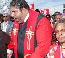 The Rev. Dr. William Barber II, president of the North Carolina NAACP and leader of the North Carolina Forward Together Moral Movement, leads marchers across the Edmund Pettus Bridge in Selma, Ala. (Photo: Wiley Henry)