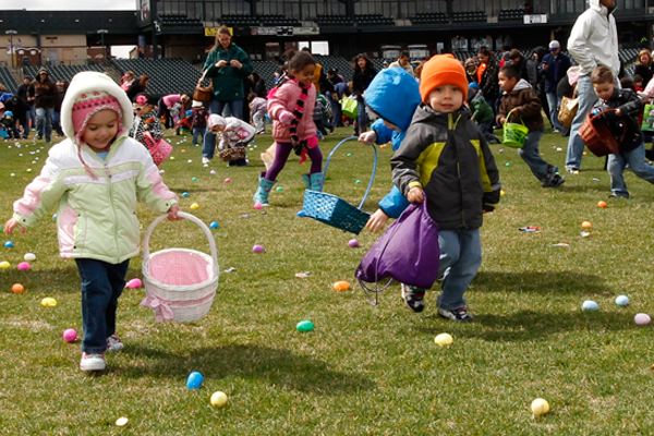 Children are divided by age groups to hunt for goodies at Silver Cross Field at the Joliet Slammers' Easter Candy Run.