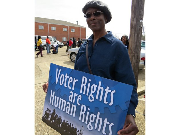 Lithonia Mayor Deborah Jackson boarded one of nine buses chartered by the Voter Empowerment Collaborative to carry her message to the Edmund Pettus Bridge in Selma, Ala.