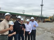 Houston City Council Member Larry Green with others on the demolish site of the old Westbury Centerette Commercial Center
