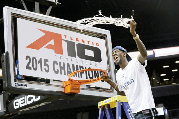 Virginia Commonwealth University basketball star Briante Weber, who suffered a season-ending knee injury in January, cuts down the net as the Rams celebrate their Atlantic 10 Conference Tournament title after Sunday's 71-65 win over University of Dayton in New York. Winning the title gives the Rams an automatic berth in the NCAA Tournament.