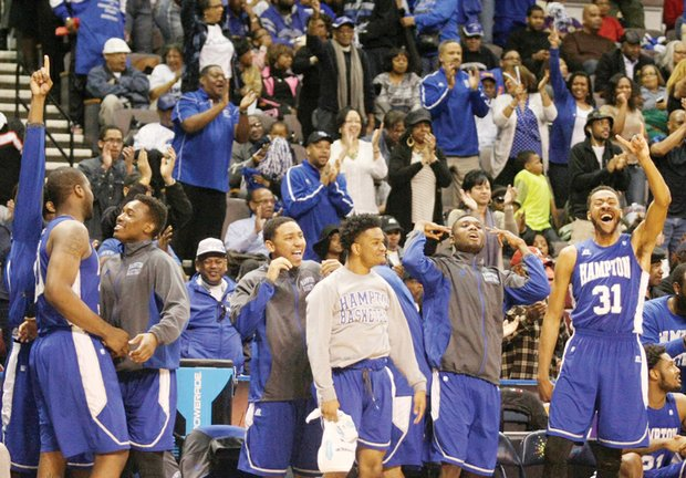 Hampton University's men's basketball team, shown above after winning Saturday's MEAC Tournament in Norfolk, will suit up Thursday night against No. 1 Kentucky in NCAA Tournament play in Louisville.