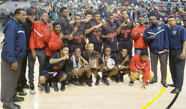 The George Wythe High School boys basketball team and coaches strike a winning pose following the team's 80-60 win over Spotswood High of Rockingham County in the 3A state championship game at the Siegel Center.