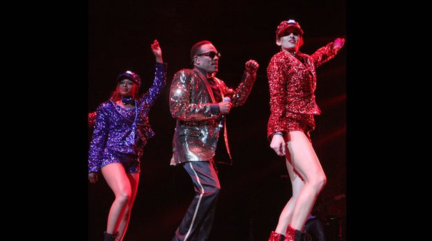 "Charlie Wilson makes his entrance, performing his signature ""Party Train"" at the FedExForum in Downtown Memphis on Friday night. (Photo: Warren Roseborough)"